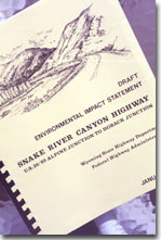 This is a photograph of an Environmental Impact Statement Report done for the proposed Snake River Canyon Highway in Wyoming