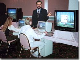 This is a photograph of John Ellsworth conducting a computer visual simulation training seminar for a group of landscape architects.